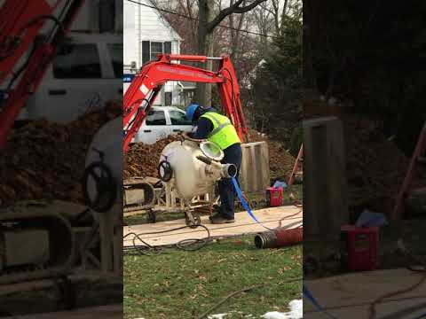 Pipe Works Home Services technicians prepping the perma-lining machine to repair a sewer line in Summit, NJ.
