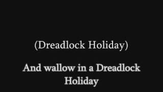 10CC - Dreadlock Holiday (lyrics)