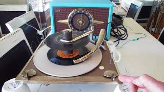 Motorola 4 speed automatic record player playing a stack of 45