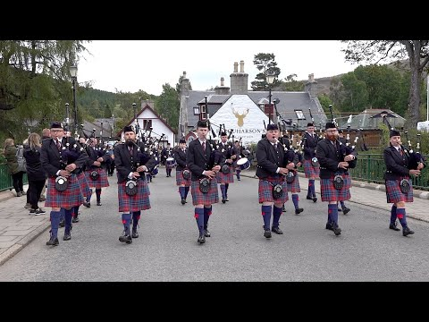 Lower Clyde Pipes and Drums from Greenock begin their march to the 2019 Braemar Gathering in Deeside