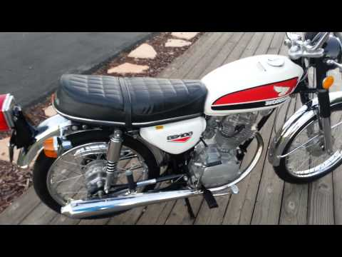 Red 1972 Honda Cb100