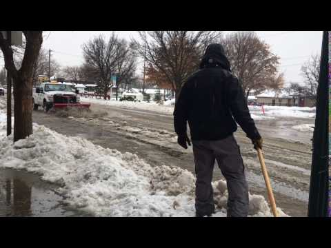Steve Burak and Team help City Service members locate and uncover City water drains buried beneath snow and ice.
