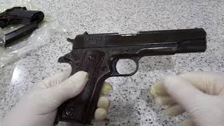 Removing guns from vacuum sealed bags after 4 years.