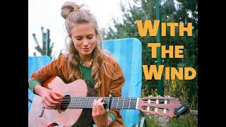 Kadr z teledysku With The Wind tekst piosenki Julia Pietrucha
