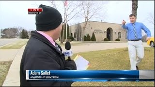 Watch a Bank Robber Interrupt This News Reporter During Live Broadcast