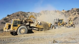 CAT D10T2 and D10N shoving 651's
