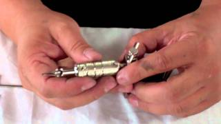 How to put a tattoo gun together?