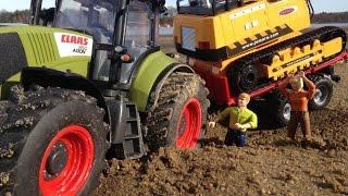 Nuotoliniu pultu valdomas traktorius | Claas Axion 870 | Happy People