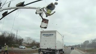 Truck crash sends worker flying out of construction bucket