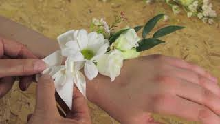 DIY Wedding Flowers - How to tie a wrist corsage by Campbell's Flower School