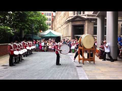The Welsh Guards having a jam with Taiko drummers.