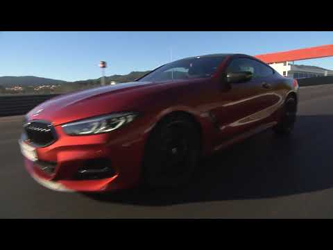 The New BMW 8 Series Coupe Driving On The Racetrack