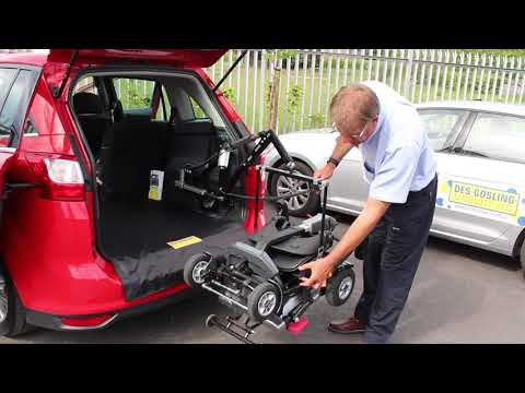 Des Gosling supplied car boot hoist provides easy unloading of a TGA Autofold mobility scooter YouTube video thumbnail