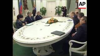 Lebanese Prime Minister Rafik Al-Hariri meets Putin in Moscow.