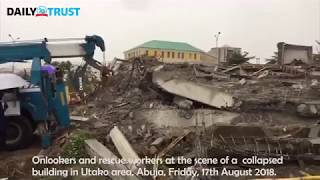 Rescue workers at the scene of Abuja collapsed building