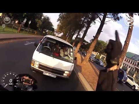 Biker forces taxi driver to follow rules of the road