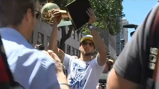 RAW: Steph Curry gets off parade bus to greet Warriors fans