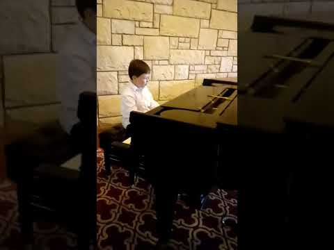 My student playing at the recital I give twice a year.