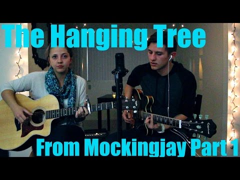 The Hanging Tree Cover from Mockingjay part 1  Buy this track here! Loudr- http://ldr.fm/dnFHV  iTunes- http://bit.ly/11RMB2D HEY GUYS!!! :) I saw Mockingjay last night and it was suuuuper good! Jennifer Lawrence did a great job singing The Hanging Tree and I really enjoyed the simple, mysterious melody so Tayler and I elaborated a bit on it and we really hope you like it!  Don't forget to give this vid a thumbs up and subscribe to both our channels if you liked it! Thanks so much! :)))  Tayler's channel- https://www.youtube.com/user/taylerlanningmusic  BE OUR FRIENDS :D  Twitta- https://twitter.com/Jakeroquemusic https://twitter.com/taylerlanning Insta- @JakeRoqueMusic @taytaylanning Facebook- https://www.facebook.com/jakeroquemusic YouNow: http://www.younow.com/Jakeroquemusic Vine: https://vine.co/u/1091226794704699392 (Jake Roque Music)  Lyrics: The Hanging Tree Hunger Games Official Song Are you, are you Coming to the tree They strung up a man They say who murdered three. Strange things did happen here No stranger would it be If we met at midnight In the hanging tree.  Are you, are you Coming to the tree Where dead man called out For his love to flee. Strange things did happen here No stranger would it be If we met at midnight In the hanging tree.  Are you, are you Coming to the tree Where I told you to run, So we'd both be free. Strange things did happen here No stranger would it be If we met at midnight In the hanging tree.  Are you, are you Coming to the tree Wear a necklace of rope, Side by side with me. Strange things did happen here No stranger would it be If we met at midnight In the hanging tree. the hanging tree remix the hanging tree song the hanging tree cover  the hanging tree lyrics the hanging tree katniss everdeen the hanging tree jennifer lawrence the hanging tree jennifer lawrence lyrics the hanging tree hunger games the hanging tree movie version the hanging tree mockingjay the hanging tree hunger games official song the hanging tree mockingjay