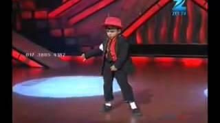 An Indian kid dancing of like Michael Jackson