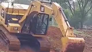EXCAVATOR OPERATED BY WOMAN