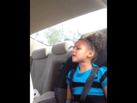 4 year old singing 'Girl on Fire' without knowing she was being recorded. Too cute