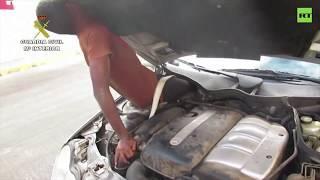 Spanish police find migrants hidden in car trunk & behind dashboard