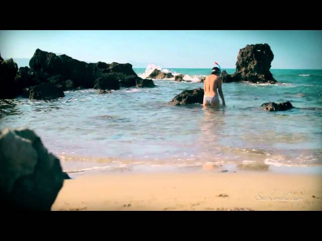 Girl snorkeling in a blue lagoon   Crete Greek