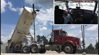 How to Dump half round end dump trailer in cab view