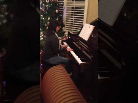 "Performing ""Oh Tannenbaum"".  This is one of my favorite Christmas pieces for piano."