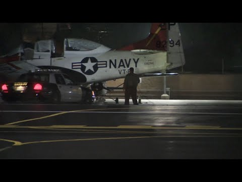 Two planes collided on a Los Angeles-area runway on Wednesday, authorities said. A single-engine plane caught fire. KABC-TV reports its pilot died. The other plane is a T-28, reportedly with Vietnam War era markings. Its pilot was hospitalized. (March 14)