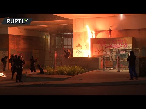 Protesters set fire to ICE building in Portland
