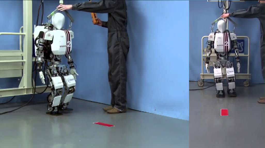 Humanoid robot WABIAN-2R walking with dynamically generated gait. The walking gait is dynamically generated using a hybrid gait pattern generator capable of rapid and dynamically consistent pattern regeneration.