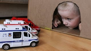 Senya plays with toy cars and rescues the Police and Fire trucks and Ambulance from the cave