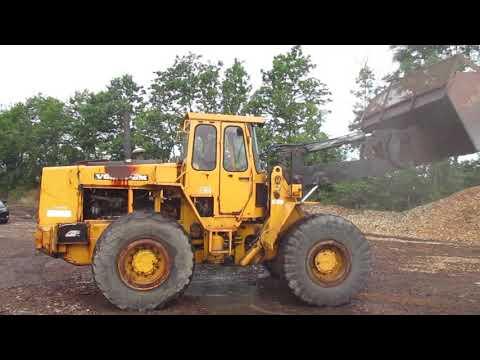 Video: Volvo 4400 gummihjulslæsser med flis/korn skovl. 1