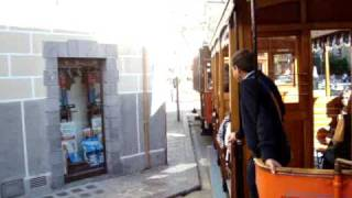 preview picture of video 'Port Soller to Soller tram ride through Plaça Constituçio. Mallorca: 4th Apr 2009'