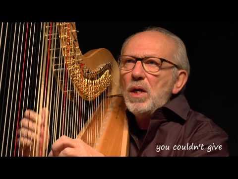 Singer song-writer harpist Luc Vanlaere sings
