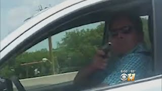 Driver Records Driver Pointing Gun At Her On Road