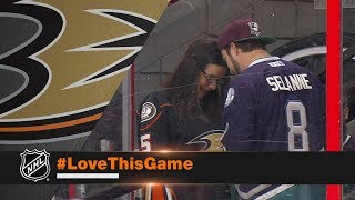 Ducks fans hold surprise engagement as players look on