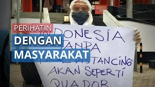 Perihatin Melihat Masyarakat Acuhkan Imbauan Pemerintah, Pria di Bangil Gunakan APD Turun ke Jalan