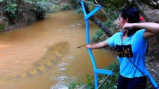 Girl Uses Bow To Shoot A Giant Fish In The Water