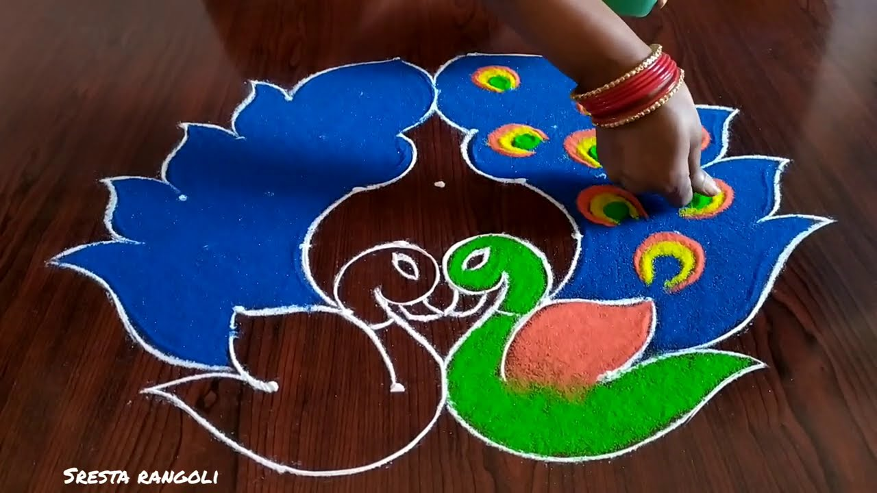 peacock rangoli design with 7 dots by sresta