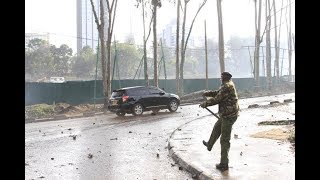 Uniformed stone throwers- Police caught on camera hurling stones at cars