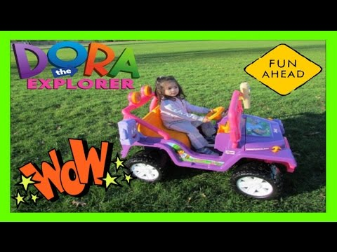 Little  Kid Driving a Jeep Wrangler Power Wheels Dora the Explorer Jeep Wrangler