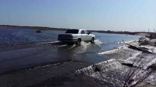 А вода по асфальту рекой.Куда ты едешь?