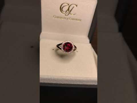 Anillo Breuning colección Beauty con granate y diamantes en oro rosa 18k
