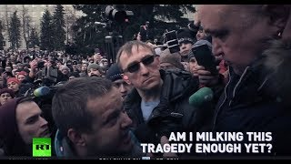 'Shame on you! Resign!' Angry crowds confront officials in Kemerovo, demanding answers