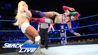 The Empress of Tomorrow takes on The Golden Goddess and The Jersey Devil, while SmackDown Women's Champion Carmella watches from ringside. Get your first month of WWE Network for FREE: http://wwenetwork.com Subscribe to WWE on YouTube: http://bit.ly/1i64OdT Visit WWE.com: http://goo.gl/akf0J4 Must-See WWE videos on YouTube: https://goo.gl/QmhBof