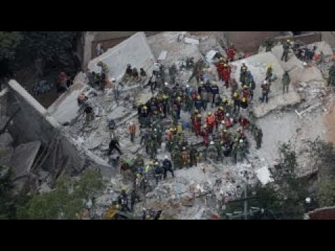 Crews work to rescue girl found alive in collapsed school