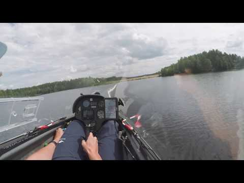 Flying a Glider Low Over the Water